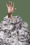Hand_rising_through_money