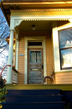 Front_porch_blue_steps_yellow_house