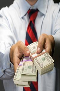 Man_handing_out_cash_2